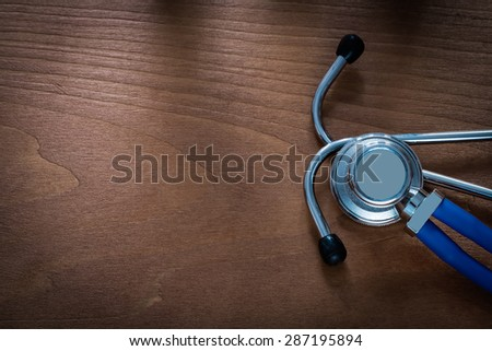 Copy space image of diagnostic tool for medical check up on pine vintage wooden board medicine concept  - stock photo
