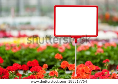 Copy space in flower bed. Close-up of copy space on the commercial sign with flower bed on the background - stock photo