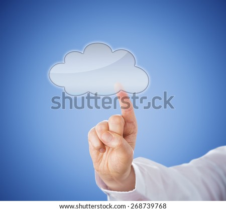 Copy space in transparent cloud computing icon which is being activated by touch. Hand in close up stretching its index finger to reach the cloud button. Light blue background. Technology metaphor. - stock photo