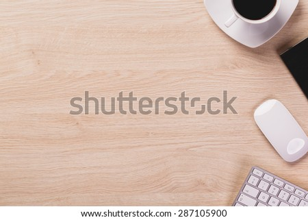 Copy space next to office equipment such as computer mouse, modern computer keyboard and cup of coffee. - stock photo