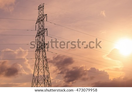 Copy space of electric pole on sunset sky and cloud background. Energy and technology concept.