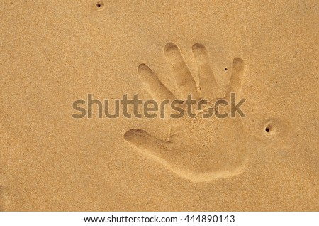Copy space of hand print on sand beach. Travel concept. Retro color style.