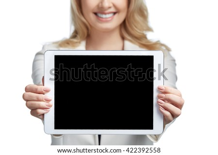 Copy space on her tablet. Beautiful young woman showing tablet and smiling. Business concept. Close up - stock photo