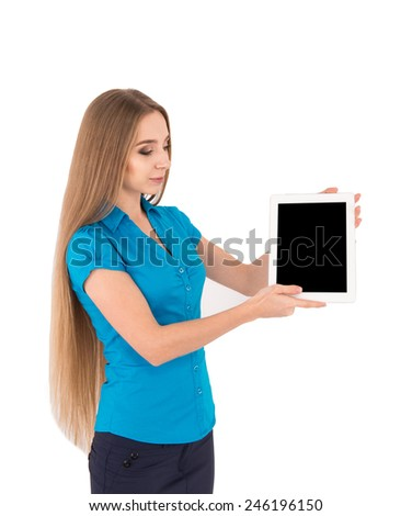 Copy space on her tablet. Young beautiful businesswoman showing her digital tablet while standing isolated on white