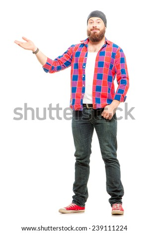 Copy space on his hand. Full length of bearded young man in casual wear pointing copy space and smiling while standing isolated on white background - stock photo