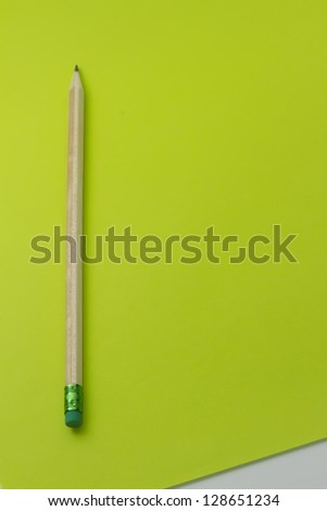 copy space with pencile with green eraser and white corner - stock photo
