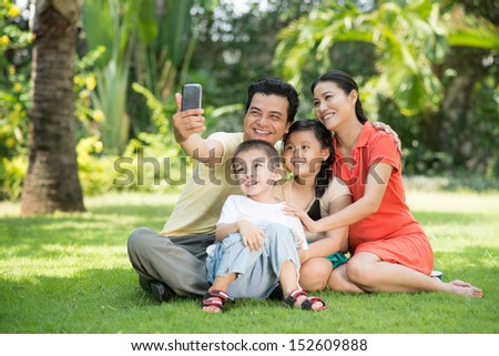 Copy-spaced image of a big family making self-portrait  - stock photo