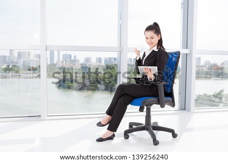 Copy-spaced image of a businesswoman during the break - stock photo