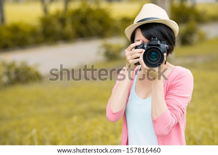 Copy-spaced image of a female photographer making a photo of you on the foreground - stock photo