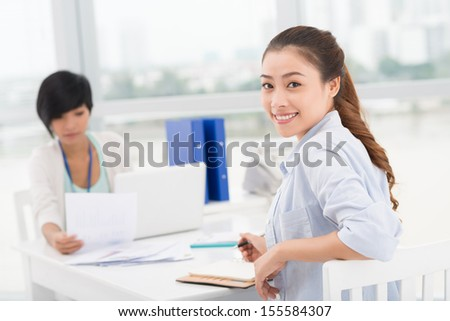 Copy-spaced image of a smiling businesswoman on the foreground