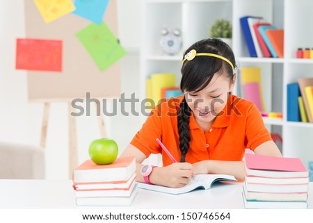 Copy-spaced image of a teenage girl doing her homework  - stock photo