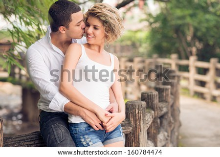 Copy-spaced image of a young amorous couple bonding in the park - stock photo
