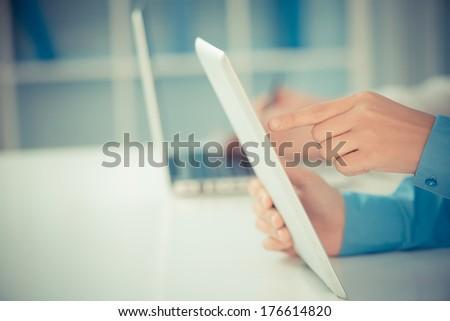 Copy-spaced image of human hands networking using modern technologies on the foreground  - stock photo