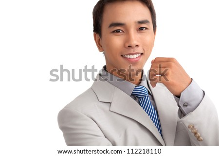 Copy-spaced isolated portrait of a smiling businessman knowing his business well - stock photo