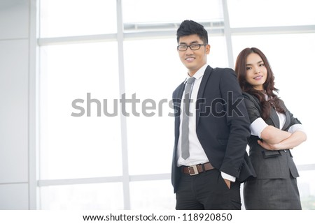 Copy-spaced portrait of an enthusiastic business team with positive attitude - stock photo