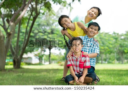 Copy-spaced portrait of joyful friends enjoying their summer vacation - stock photo