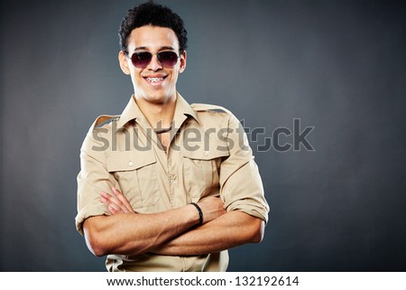 Copy-spaced shot of a happy dude posing against black background - stock photo