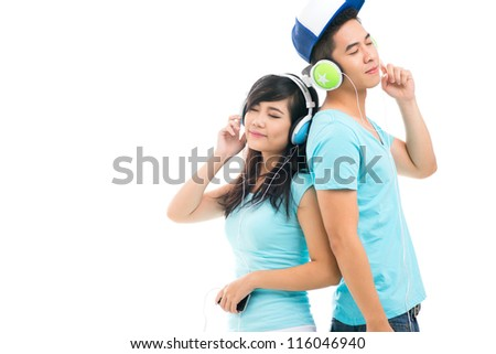 Copy-spaced shot of teenage friends enjoying music - stock photo