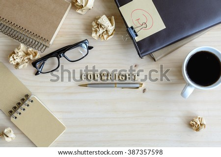 copyright document folder and desk office, concept of copyright - stock photo