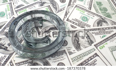 Copyright glass symbol on a background of dollar bills