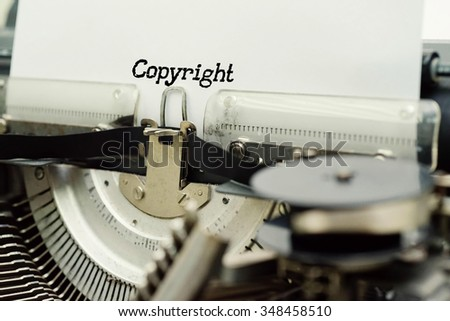 Copyright - Paper Sheets in Old Vintage Typewriter . Business concept on Toned, Grain Effect, Shallow Depth Of Field and Blurred Background - stock photo