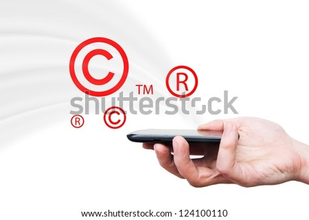 Copyright, trademark symbols flying from smartphone. Security and piracy composition - stock photo