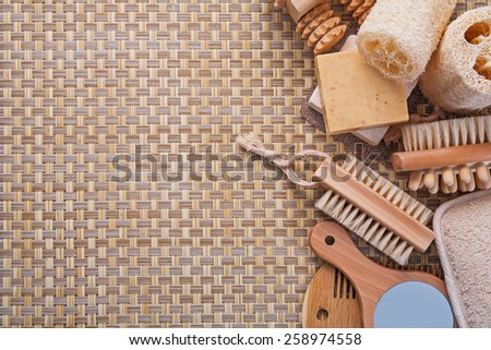 copyspace background big set of classical bathroom accessories on wicker background  - stock photo