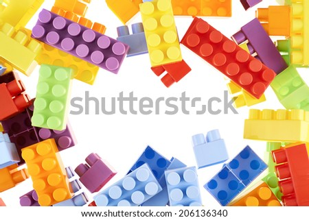 Copyspace background composition made of toy construction brick blocks against the white backdrop - stock photo