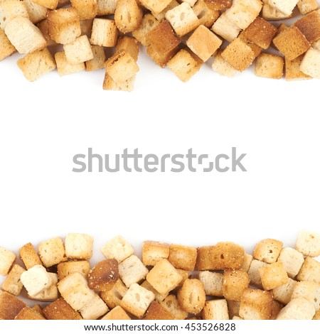 Copyspace background composition with the borders made of garlic white bread croutons isolated over the white - stock photo
