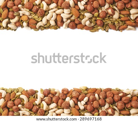 Copyspace background composition with the borders made of multiple different nuts and seeds isolated over the white background - stock photo