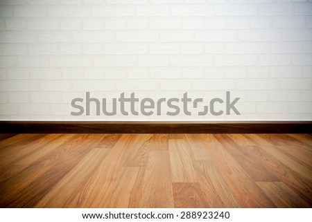 Copyspace background with an empty white bricks wall with a hardwood wooden floor below with large copy space for your text or advertisement - stock photo