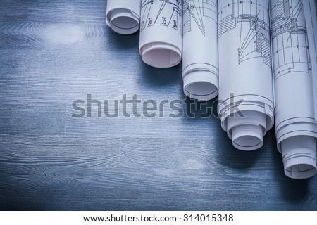 copyspace image rolls of blueprints on blue board. - stock photo