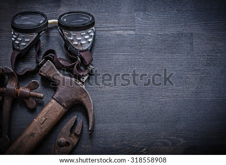 copyspace image vintage tools  hammer pliers goggles clamp. - stock photo
