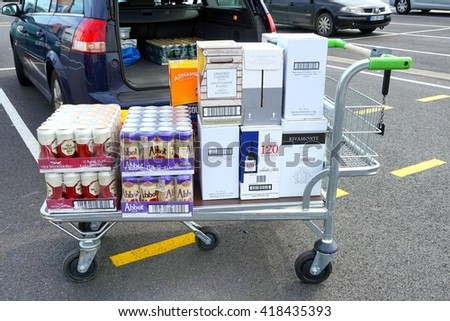 COQUELLES, PAS-DE-CALAIS, FRANCE, MAY 07 2016: Shopping trolley loaded with cheap beer and wine