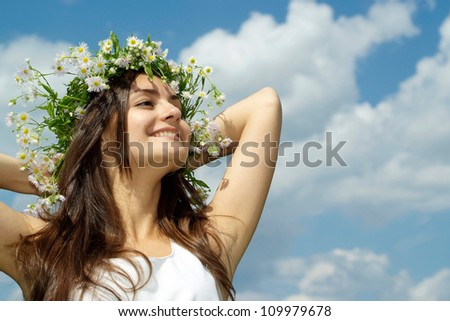 Coquettish brunette went to rest on the nature - stock photo