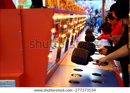 Coquitlam, BC, Canada - April 09, 2015 : People playing whack game at carnival - stock photo