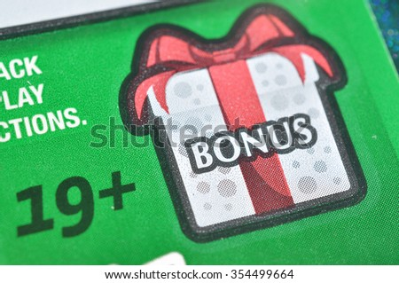 Coquitlam BC Canada - December 19, 2015 : Close up bonus section on lottery ticket. The British Columbia Lottery Corporation has provided government sanctioned lottery games in BC since 1985.  - stock photo