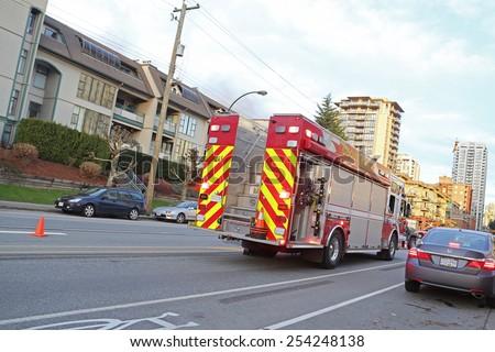 Coquitlam, BC, Canada - February 16, 2015 : A firetruck stopped on a street in Coquitlam BC Canada..  - stock photo