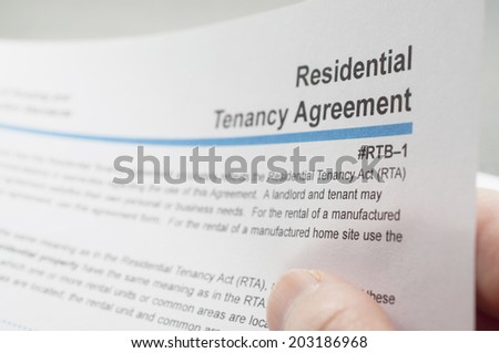 Coquitlam BC Canada - June 15, 2014 : Close up woman reading residential tenancy agreement in Coquitlam BC Canada.