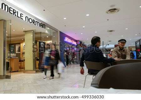 Coquitlam, BC, Canada - October 12, 2016 : Blur motion of people shopping and sitting at rest area inside Coquitlam shopping mall