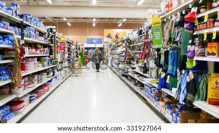 Coquitlam, BC, Canada - October 08, 2015 : One side of shopper at kitchen items corridor in Save on Foods. It is a regional chain of supermarkets located in British Columbia, Canada. - stock photo