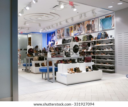 Coquitlam, BC, Canada - October 08, 2015 : People looking shoes at shoe store - stock photo