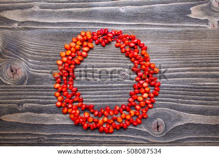 coral beads on a wooden background