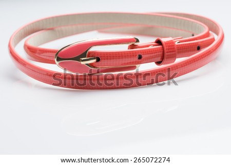 coral female belt. buckle