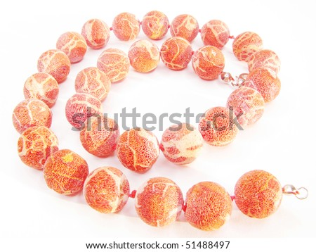coral red colored beads isolated on white background