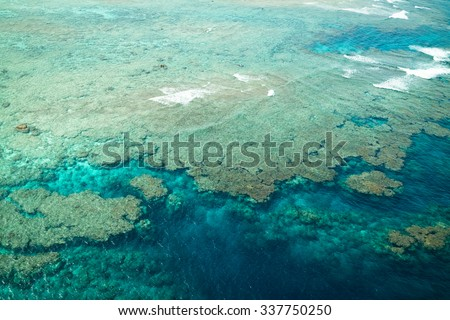 Coral reef and clear blue water from above, Amami Oshima Island, Kagoshima, Japan - stock photo
