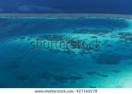 Coral Reef and detail of Atoll in Indian Ocean, Maldives, View from seaplane window - stock photo