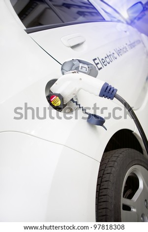 Cord hanging down from gas tank location on this electrical vehicle - stock photo