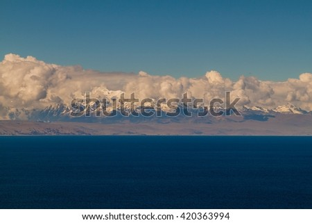 Cordillera Real mountain range behind Titicaca lake, Bolivia - stock photo
