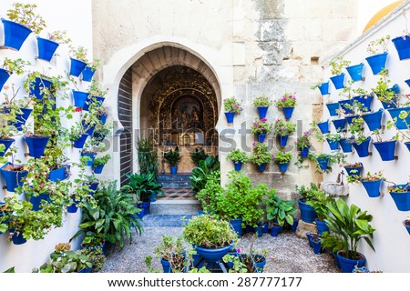 Cordoba, Andalusia Region, Spain. An old church with the traditional flowers set up of this town.